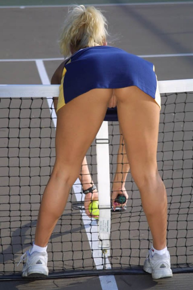 Sexy Female Tennis Player In A Skirt On Green Court Grass